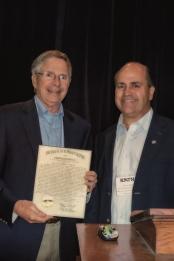 State Representative Steve Riggs presents legislative citation to Dr. George Herring at KATH conference, September 15, 2012